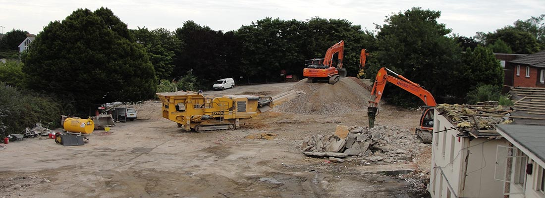 Wessex Demolition on site with the crusher in Chichester, West Sussex